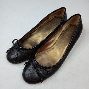 Coach women's sz 9B brown leather signature bow to